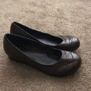 Brown shoes with a tiny wedge